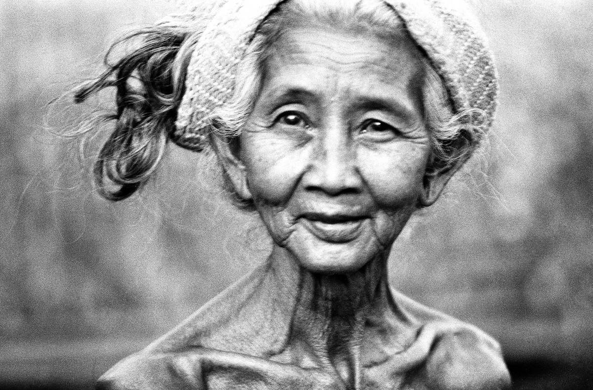 Woman with hat in Bali, Andy Summers